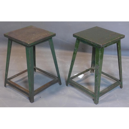 688 - A pair of industrial metal stools, stenciled 6ECME to bases, H.54cm...