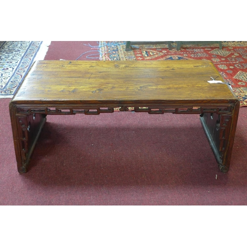 690 - A Chinese hardwood low table, with carved and pierced frieze, H.35 W.87 D.46cm...