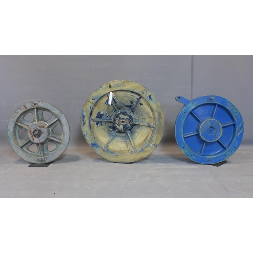 691 - Three foundry pattern moulds for wheels, each on a black stand, Diameter 65.5cm (largest)...