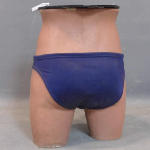 696 - An unusual lamp table made from a half mannequin wearing speedos, marked Coopers Y Front, H.38cm...