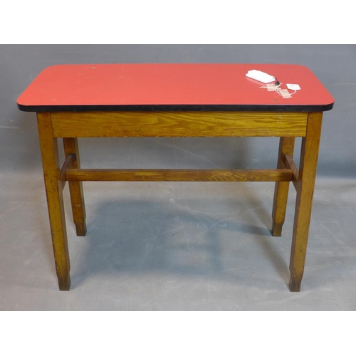 714 - A mid 20th century bar table, with pink Formica top, on square tapered legs, H.73 W.90 D.37cm (top l...