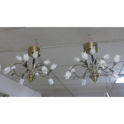 715 - A pair of 12 branch chandeliers by Dar Lighting, with white glass tulip shades and floral stems, H.3...