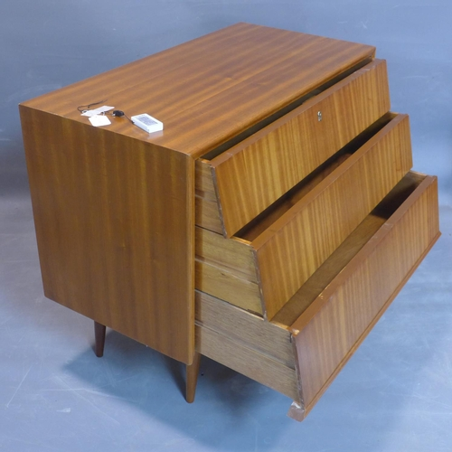 737 - A chest of three angled drawers, on tapered legs, H.77 W.92 D.46cm...