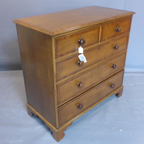 739 - A 19th century oak and mahogany crossbanded chest of two short over three long drawers, on bracket f...