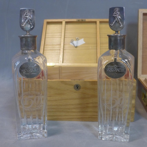 762 - Two Johnnie Walker 150th Anniversary Decanters with wooden box, together with The Humidor - Havanas ...