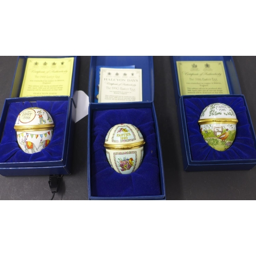 780 - A collection of seven boxed Halcyon Days enamel Easter eggs, to include 1984-1990, each with certifi...