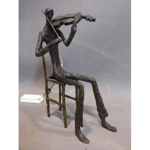 782 - A cast bronze figure of a violinist in the style of Giacometti, H.27cm...