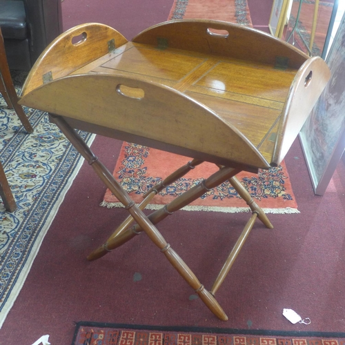 806 - A Victorian mahogany butler's tray and stand, with ratchet hinged sides, each side with an open hand...