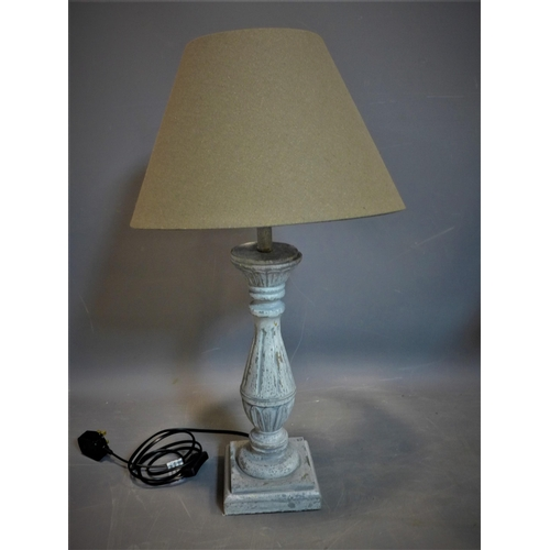 505 - A distressed painted table lamp with cream shade, H.65cm (total)...