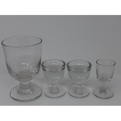 510 - Four 19th Century glasses, including a large rummer, H.14cm, a pair of two penny licks, H.8.3cm, and...