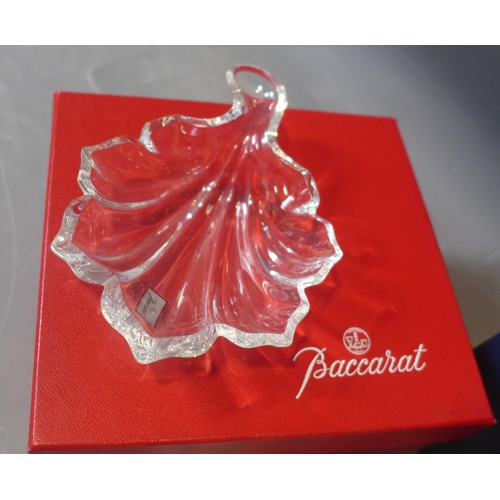 511 - A boxed Baccarat crystal leaf dish, with etched maker's mark, H.2.5 W.9.5 D.13cm, together with a bo...