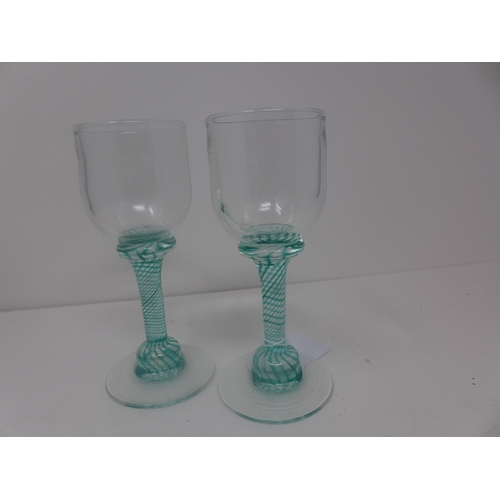 512 - A pair of schnapps glasses designed by Andrew Sanders signed, 21st century, H.22cm...