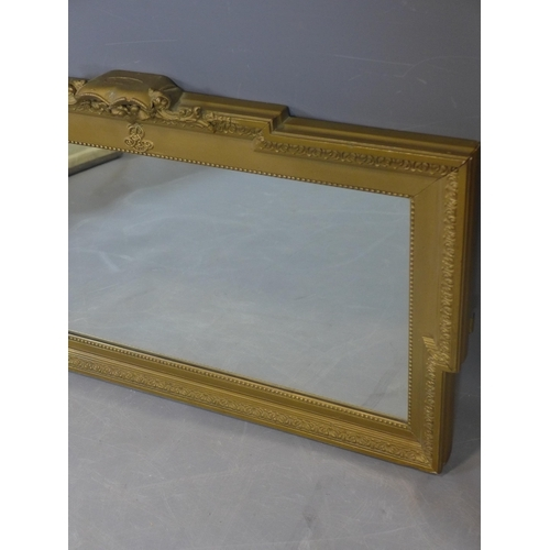 515 - A 19th century giltwood mirror, with out-stepped frame and floral pediment, 47 x 77cm...