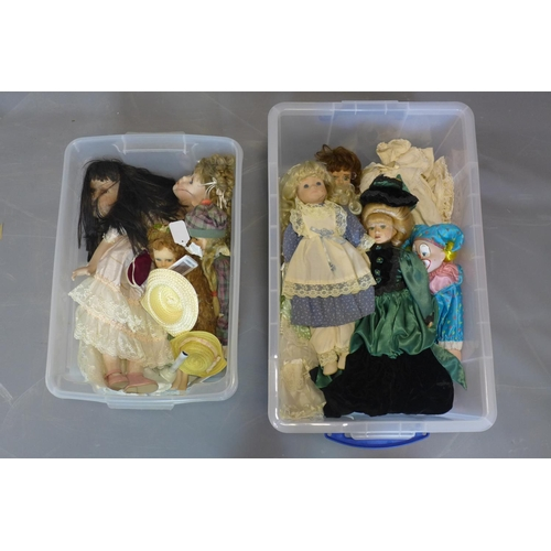 517 - Collection of ceramic dolls and handmade clothes, approx 25, late 20th century....