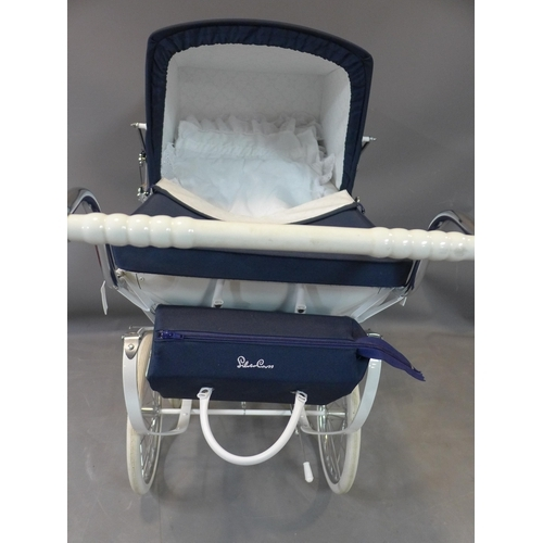 519 - A Silver Cross Heritage toy pram with navy hood, bearing maker's mark and label, H.97 W.46 D.97cm...