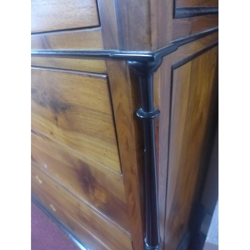 535 - A mahogany and ebonised chest of five drawers with marble top, having ebonised and turned pillars fl...