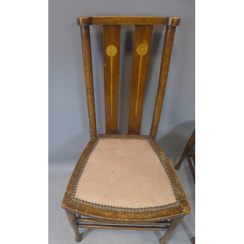 536 - A pair of late 19th century mahogany inlaid chairs, with inlaid back splats and stud bound seat, on ...