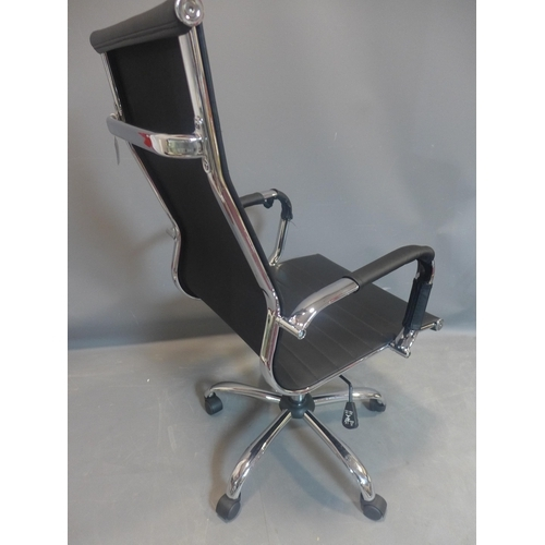 544 - Eames style black leather swivel office chair...