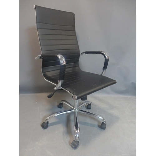 545 - Eames style black leather swivel office chair...