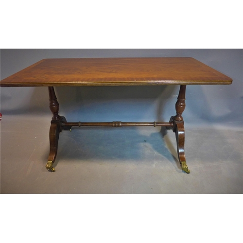 546 - A 20th century mahogany occasional table, with cross-banded top raised on turned supports and outswe...