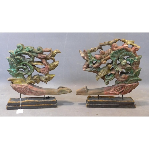22 - A pair of Southeast Asian pierced wooden carvings, polychrome painted with scrolling decoration and ...