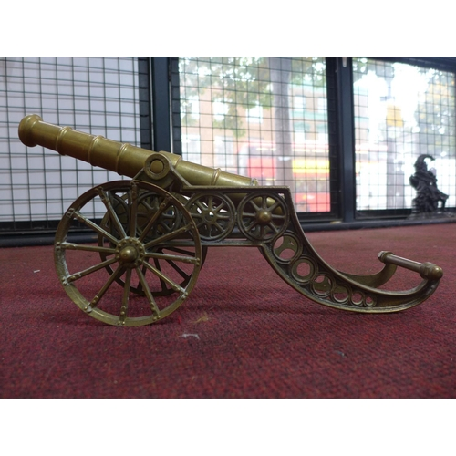 89 - Two bronze cannons H21cm x L41cm  and a set of brass scales with weights...