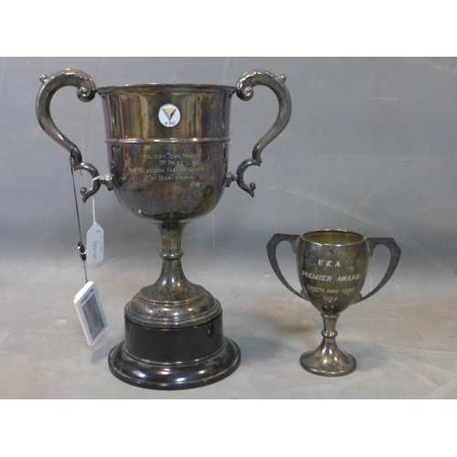 106 - A large twin handle silver plated trophy for 'Holiday Town Parade 1st Price Television Fashion Queen...