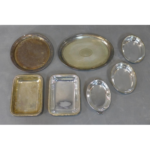 112 - A collection of seven silver plated trays, mostly 19th century...