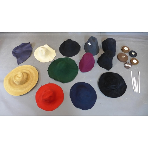 145 - A group of hat making tools including twelve pieces of felt and and ribbons...