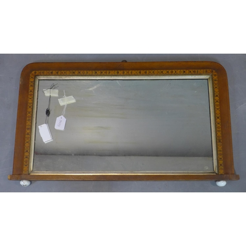 173 - An inlaid overmantle mirror with original glass plate, on ceramic ball feet, 49 x 85cm...