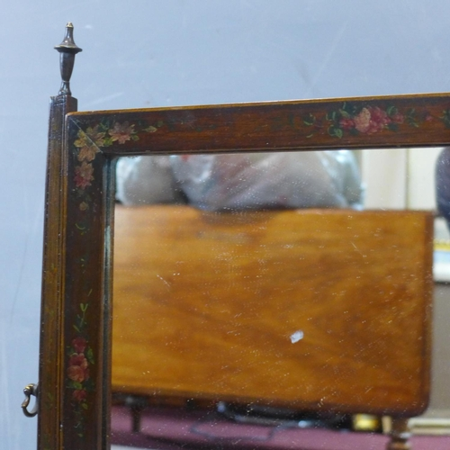 176 - A toilet mirror painted with cherub and flowers, having three drawers, raised on bracket feet, H.61 ...