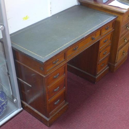 3 - A Victorian mahogany pedestal desk, having an arrangement of nine drawers, on pedestal base, H.72 W....