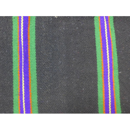 5 - A woollen rug with purple, green, yellow and orange stripes on a black ground, 223 x 143...