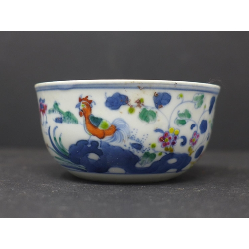 31 - A Chinese doucai chicken tea cup, decorated with chickens and flowers, with double blue circle to ba...