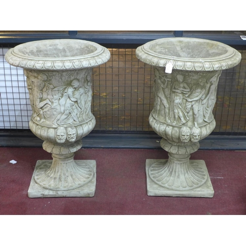 33 - Two reconstituted stone Zoffoli style urns, decorated with continuous procession of Classical figure...