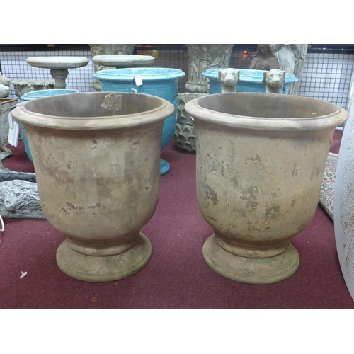 38 - Two large terracotta Provence urn style planters, H.68cm Diameter 60cm...
