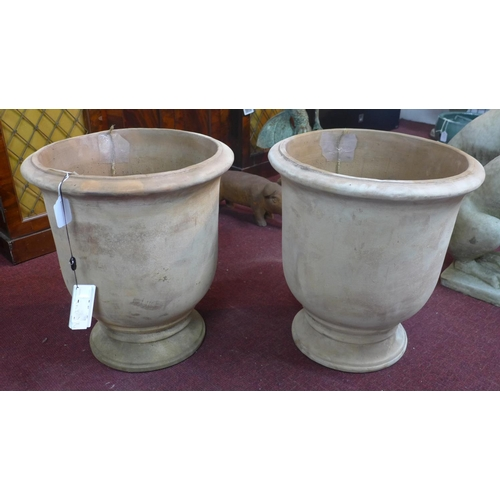 39 - Two small terracotta Provence urn style planters, H.50cm Diameter 45cm...