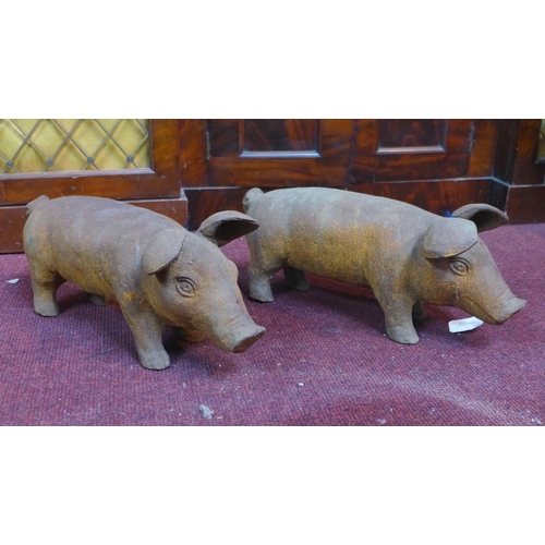 45 - Two cast iron pigs, H.18 W.43 D.15cm...