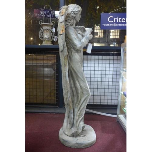 46 - A cast plaster angel holding a bird, H.121cm...