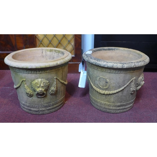 47 - Two stoneware pots with lion head decoration, H.27cm Diameter 53cm...