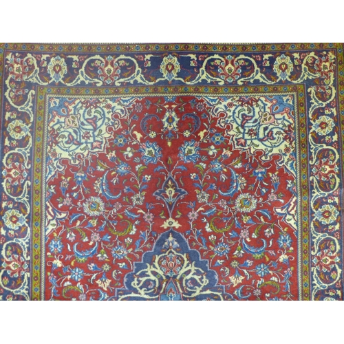 58 - A central persian Qum Rug 200cmx140, central double pendant medalion, with repeat floral motifs, and...