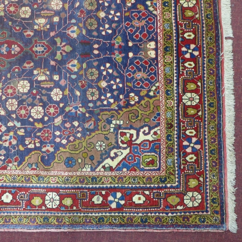 59 - North west persian Sarouk Rug, 214cmx130cm, central double pendant medalion with repeat petal motifs...
