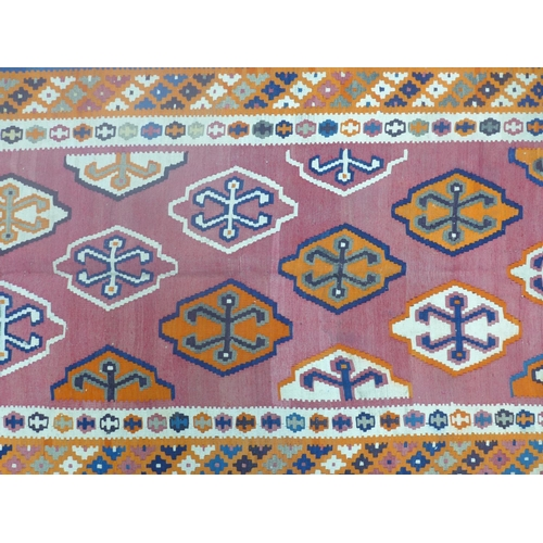 61 - A south west Persian kilim 300cm x 79cm, diamond medallion on terracotta field, and geometrical bord...