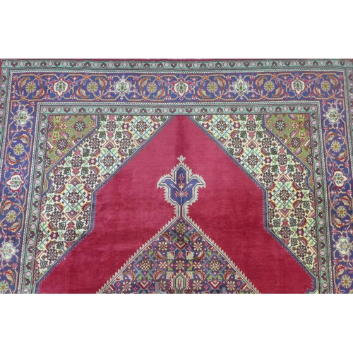 62 - A north west persian Tabrize carpet 350cm x 250cm, central double diamand medallion on rouge field, ...