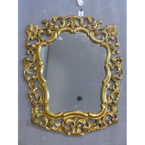 66 - A Rococo style mirror, hand carved gilded frame with floral motives, 20th century, 85 x 70 cm...
