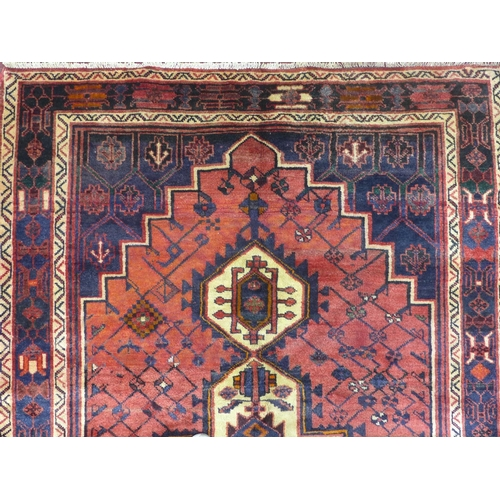 70 - A north west Persian Afshar rug, 240cm x 160cm, triple polo medallion, with repeating geometrical mo...