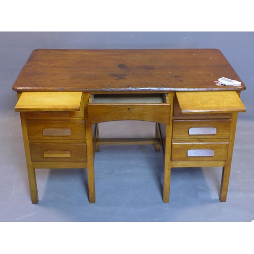 73 - An early 20th century oak desk, having six drawers flanking central short drawer, on square legs, H....