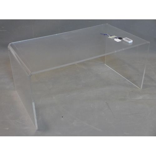 79 - A perspex table, H.40 W.90 D.50cm...