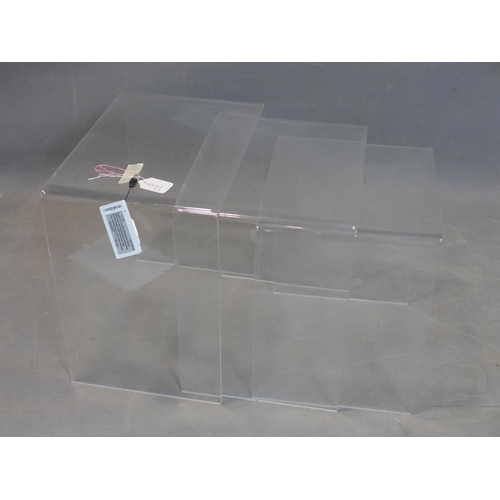 80 - A perspex nest of three tables, H.43 W.43 D.32cm (largest)...
