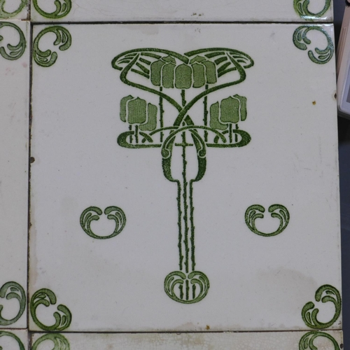 86 - A tray inlaid with Art Nouveau tiles 41cmx31cm....